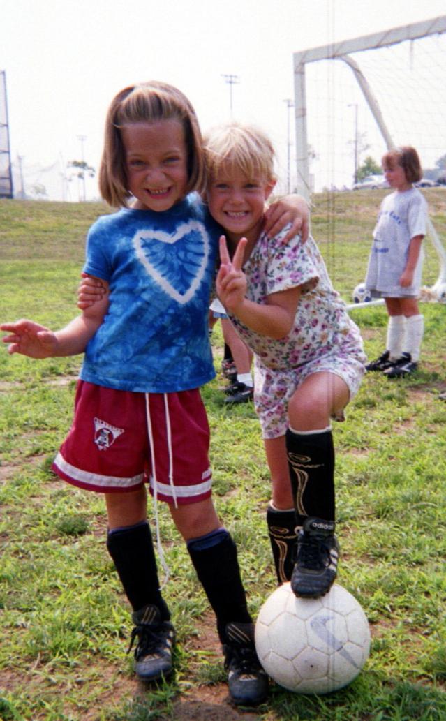 2girlsfootonballstanding